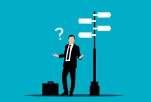 businessman, confused, street sign